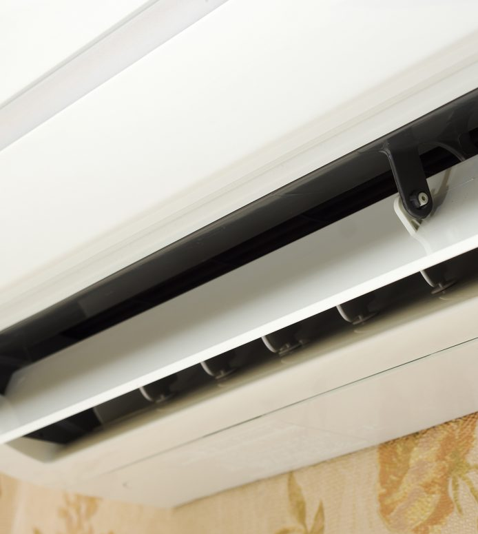 Close up of split system air conditioner in home interior